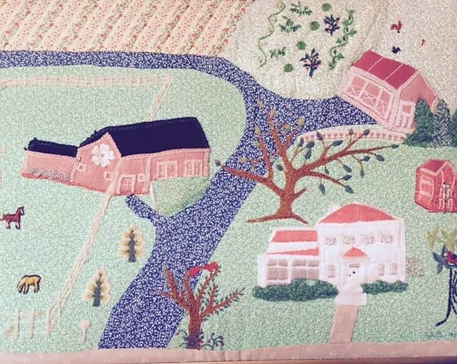 Quilted hanging of family homestead by Suzanne Benedict